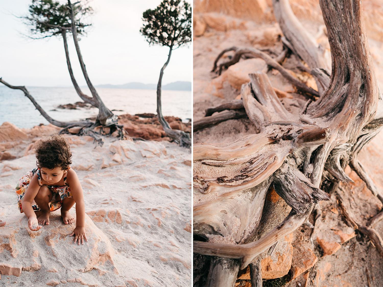 Servizio fotografico reportage di Famiglia. Bimba con vestito rosa su roccia rosa sulla spiaggia al tramonto. Palombaggia, Santa Giulia, Corsica. by rebecca rinaldi photography