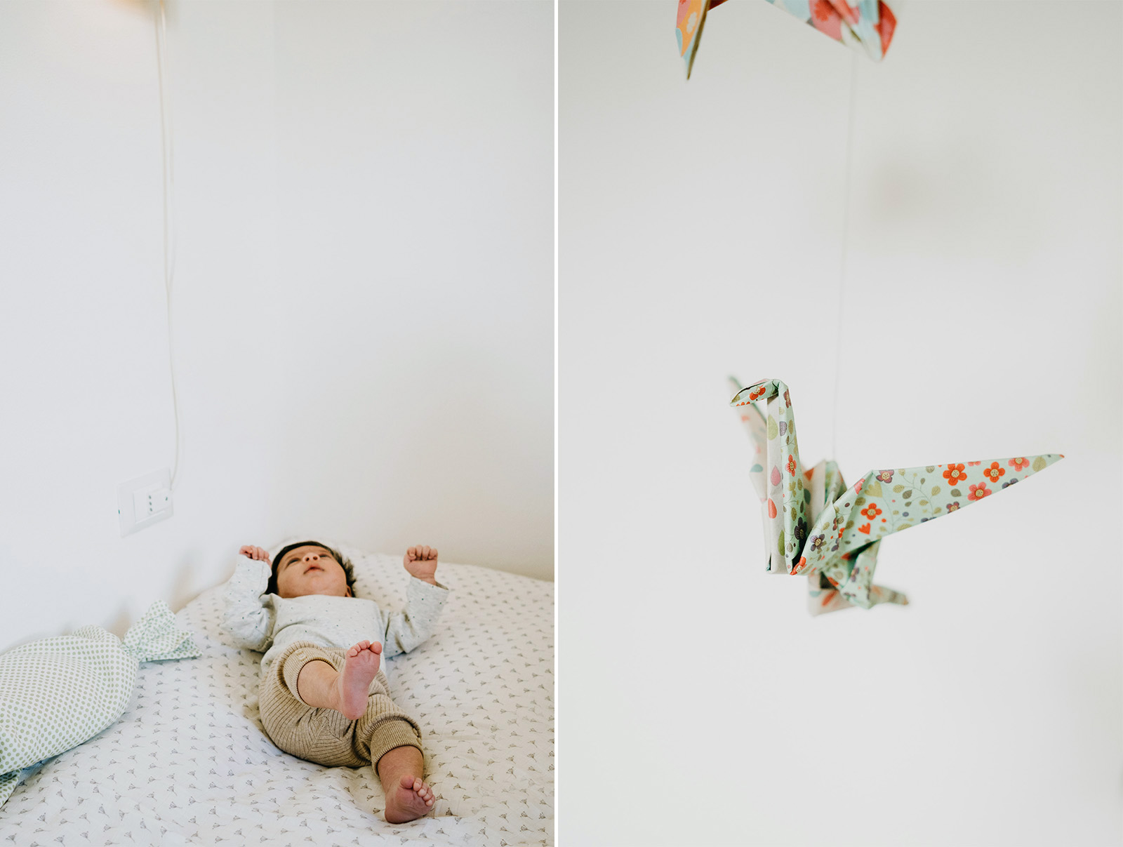 rebecca rinaldi  family photography.   baby alone on bed looking at origami hanging.